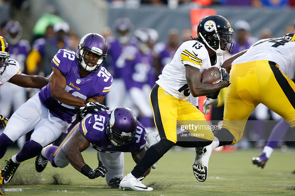 Dri Archer #13 of the Pittsburgh Steelers runs away from pursuit by Gerald Hodges #50 and Antone Exum Jr. #32 of the Minnesota Vikings in the first half of the NFL Hall of Fame Game at Tom Benson Hall of Fame Stadium on August 9, 2015 in Canton, Ohio.