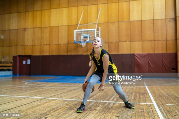 dribbling a ball - women's basketball stock pictures, royalty-free photos & images