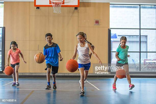 dribbling basketballs up the court - sporting term stock-fotos und bilder