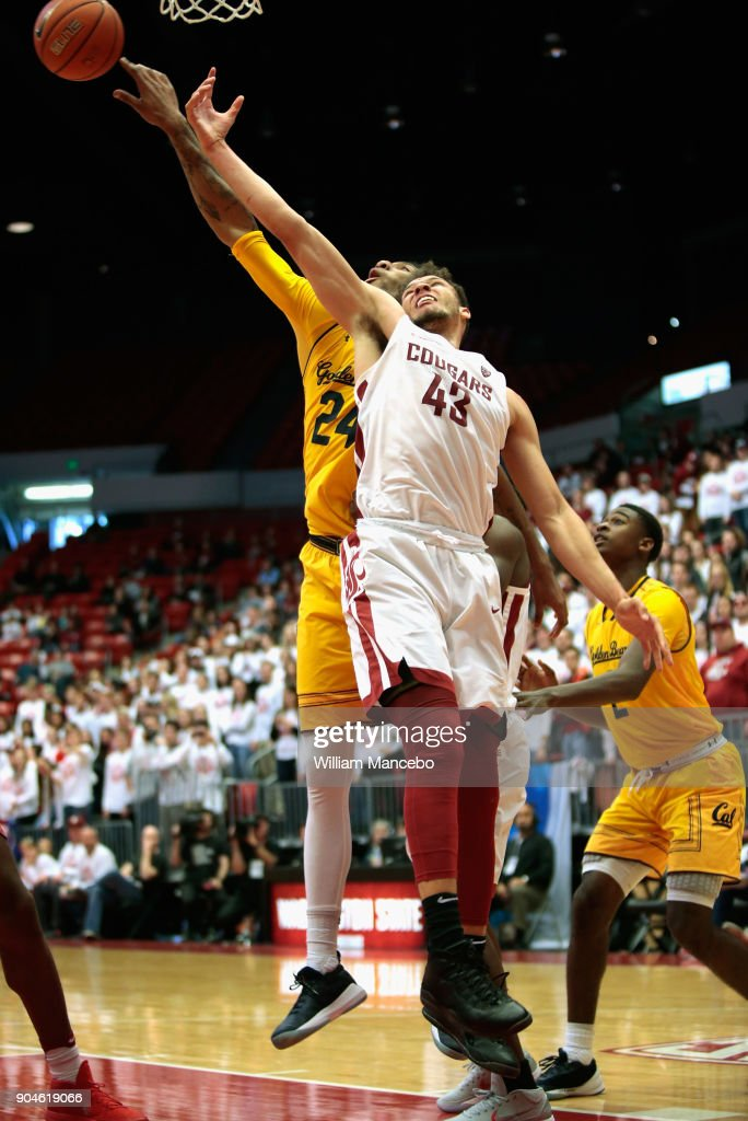 Drick Bernstine #43 of the Washington State Cougars reaches for a rebound against Marcus Lee #24 of the California Golden Bears in the second half at Beasley Coliseum on January 13, 2018 in Pullman, Washington. Washington State defeated California 78-53.
