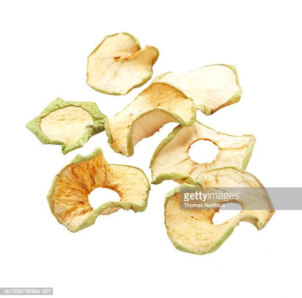 Dried apple rings on white background