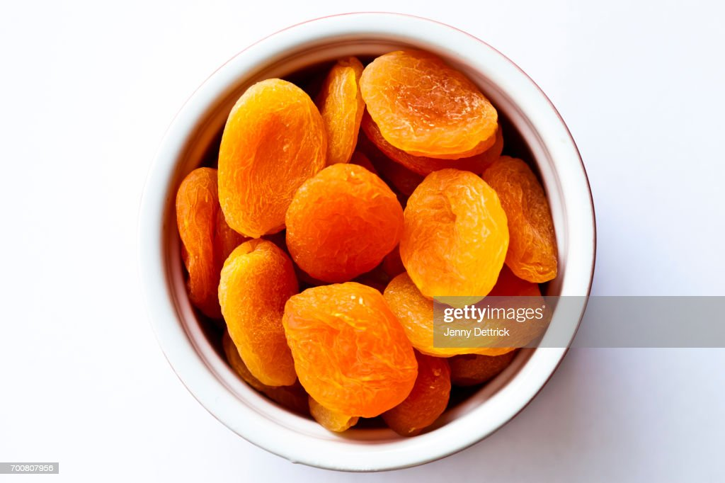 Dried apricots in bowl : Stock Photo