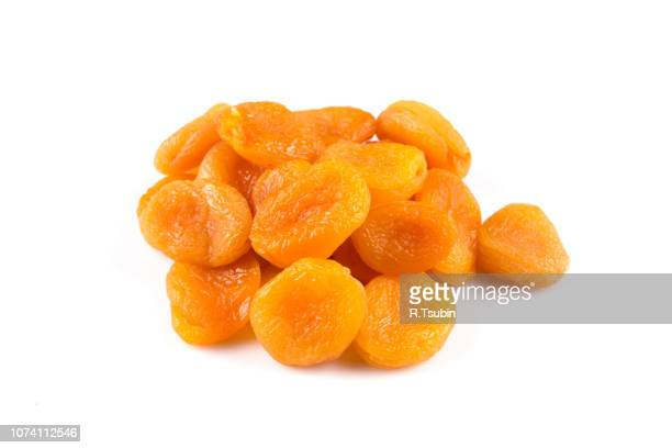 dried apricots isolated on a white background - apricot stock pictures, royalty-free photos & images