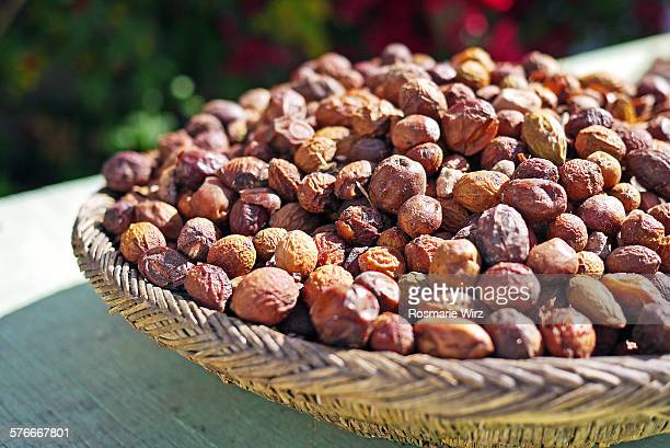 Dried argan fruit in a basket