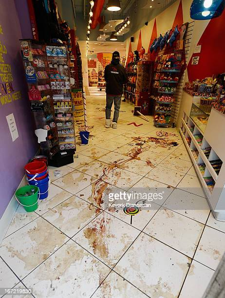 Dried blood trails are still visible inside the Sugar Heavan store near the finish line of the Boston Marathon on April 22 2013 in Boston...