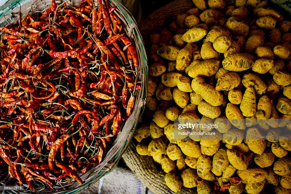 Dried chillies and turmeric root for sale at the market : Stock Photo