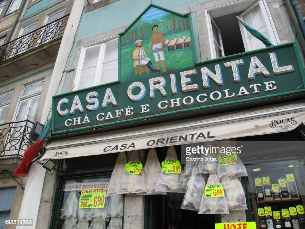 Dried cod hanging on the door of Casa Oriental is one of the oldest traditional grocery stores Oporto is located next to the Tower of Clerics and...
