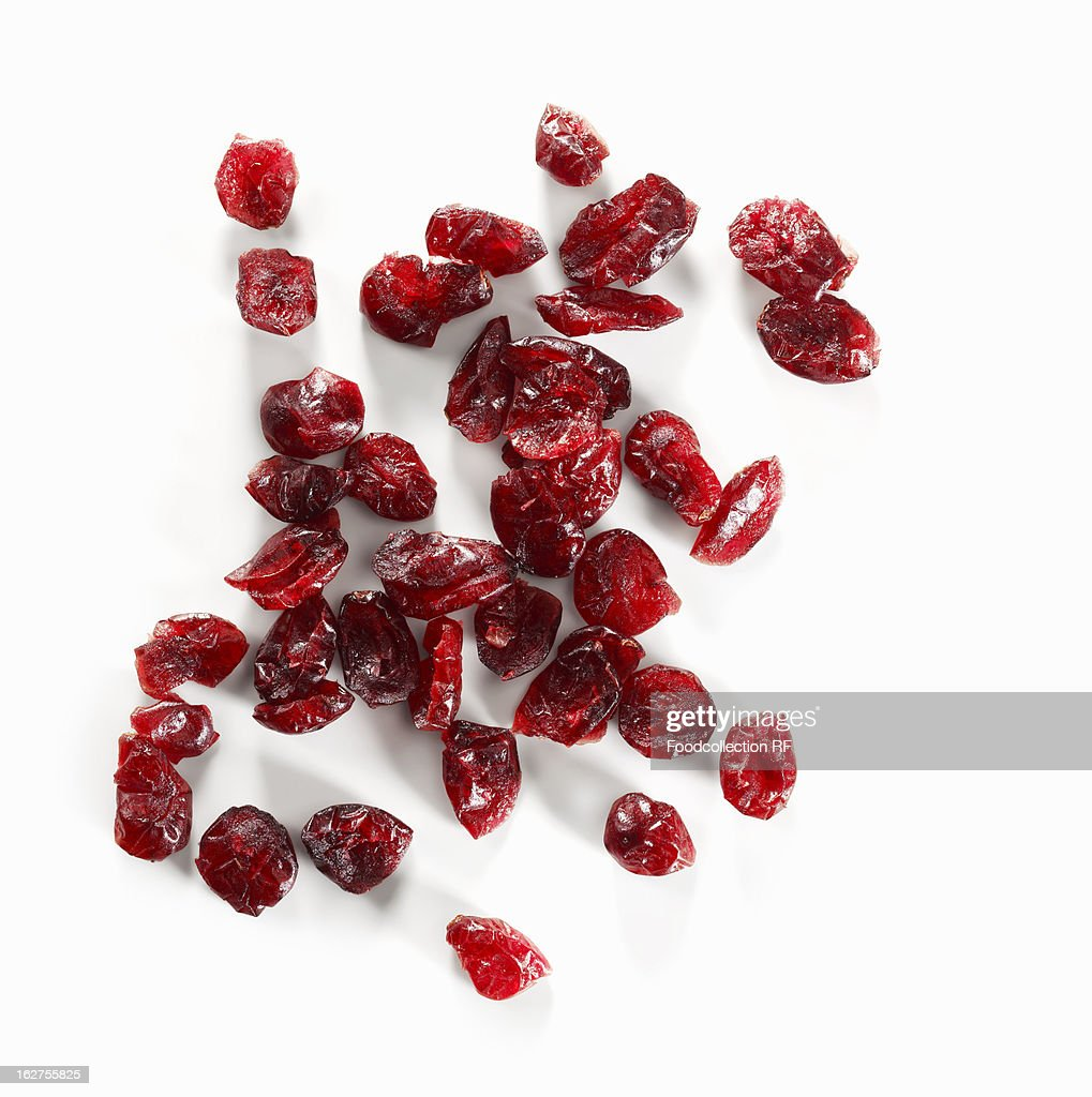 Dried cranberries on white background : Photo