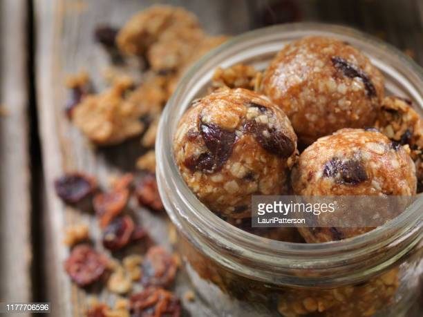 dried cranberry and oat energy balls - sphere stock pictures, royalty-free photos & images