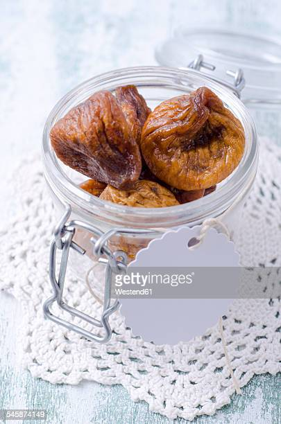 dried figs in preserving jar - doily ストックフォトと画像