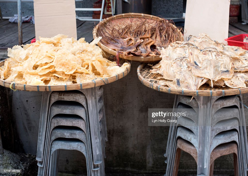 Dried fish for sale in baskets : Stock Photo