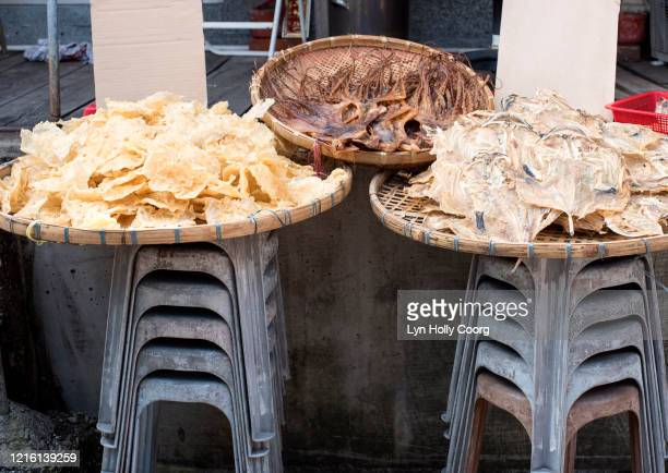 dried fish for sale in baskets - lyn holly coorg stock pictures, royalty-free photos & images