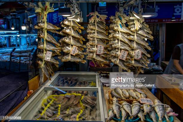 Dried fish hanging in a market in Seoul.