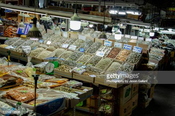Dried fish in boxes in a market in Seoul.
