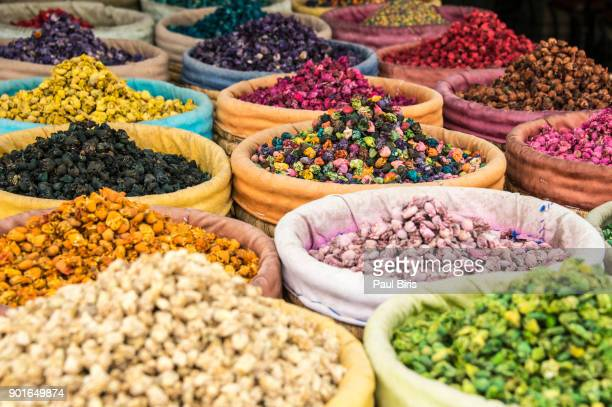 dried flowers, marrakesh souk, morocco - moroccan culture stock photos and pictures