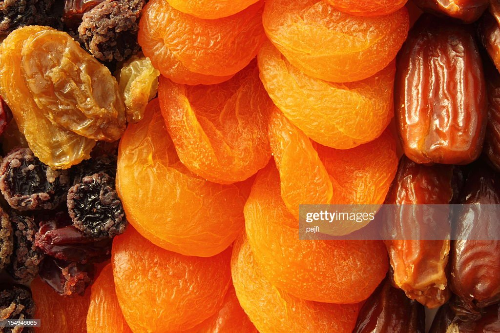 Dried fruit assortment of dates, raisins and apricots : Stock Photo