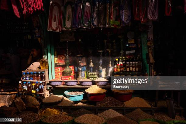 Dried fruits nuts and spices are displayed alongside shisha pipes outside a store at Mandai Bazaar in Central Kabul Afghanistan on Thursday July 12...