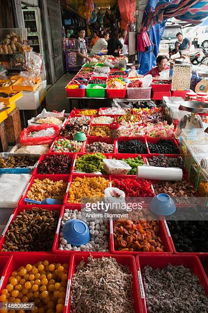 Dried fruits, sweets and other snacks for sale in stalls along Jalan Market.