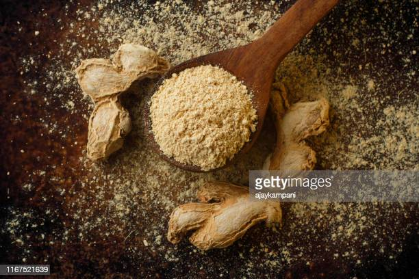dried ginger  and ground ginger, close up - ginger spice stock pictures, royalty-free photos & images