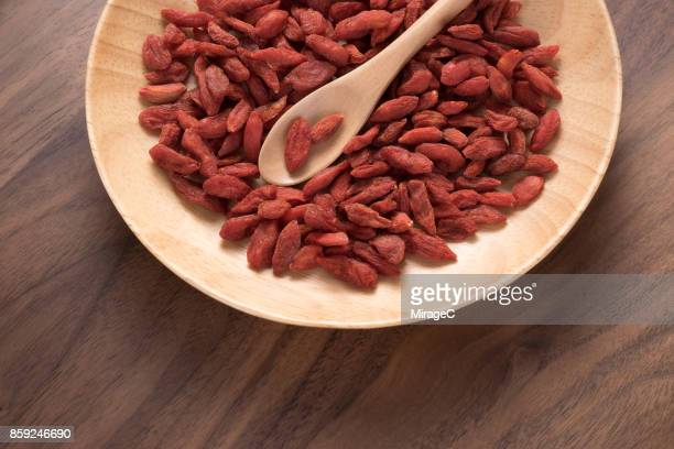 Dried Goji Berries in Wooden Plate