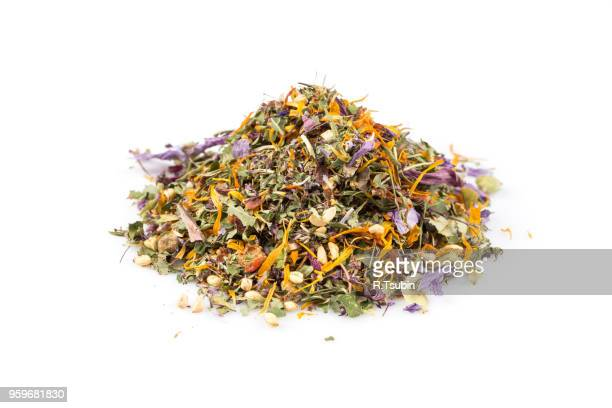 dried herbal flower tea leaves over white background - chamomile tea stock photos and pictures