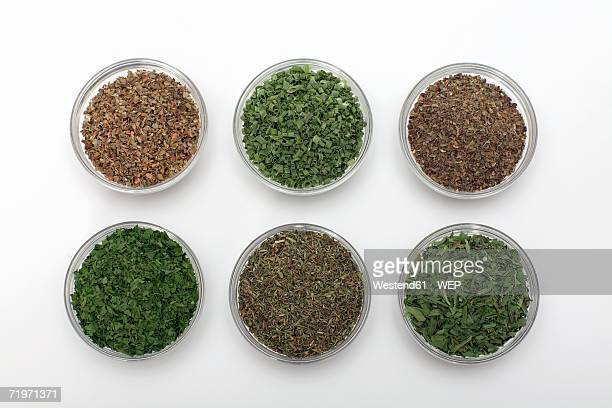 Dried herbs in bowls, close-up