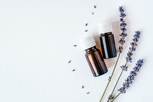 Dried lavender with a bottle of essential oil 1142788843