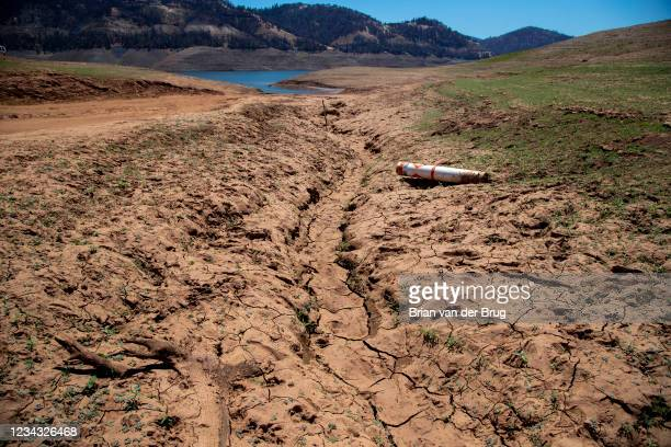 Dried mud and a stranded buoy on the lakebed at Lake Oroville, which stands at 33 percent full and 40 percent of historical average when this...