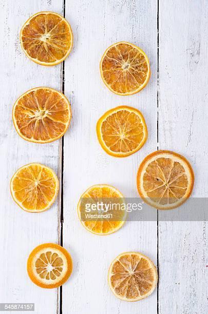 Dried orange slices on white wood