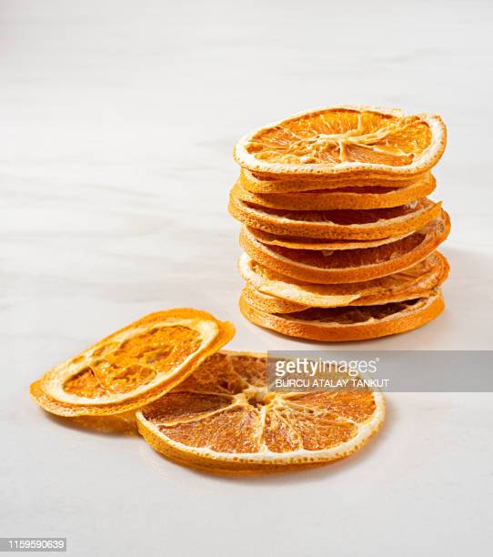 dried orange slices - dried food stock pictures, royalty-free photos & images