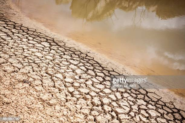 A dried out bank of a nearly water empty dam is pictured on a farm in Piket Boberg Piketberg north of Cape Town on March 7 2018 as a result of a...