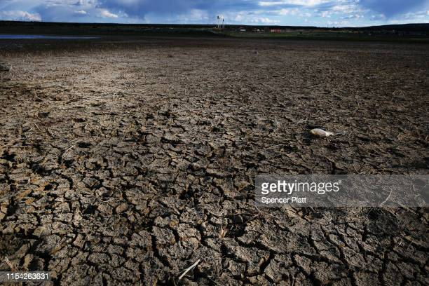 Dried out lake stands near the Navajo Nation town of Thoreau on June 06, 2019 in Thoreau, New Mexico. Due to disputed water rights and other factors,...