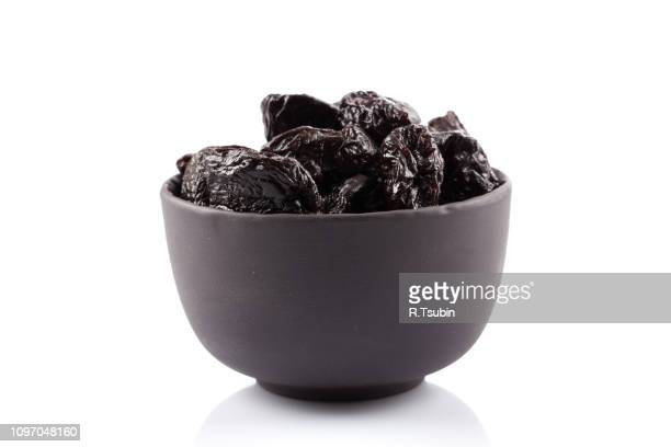 dried plum - prunes fruits - dörrpflaume stock-fotos und bilder