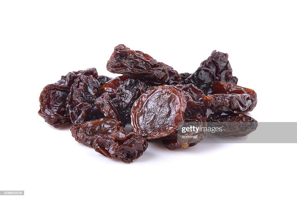 Dried raisins on a white background : Stock Photo