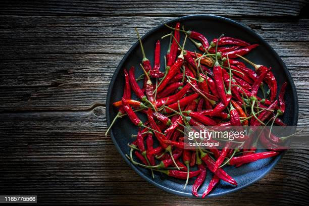 dried red chili peppers shot from above - jalapeno pepper stock pictures, royalty-free photos & images