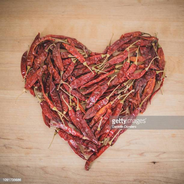 Dried red hot chili peppers in a heart shape
