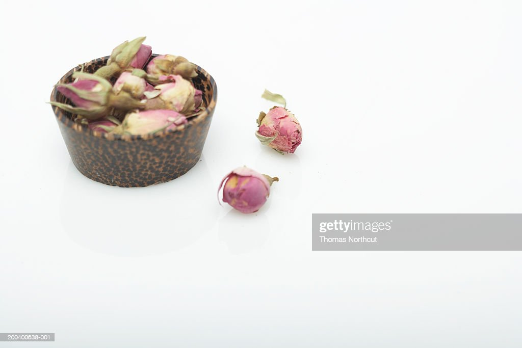 Dried rosebuds in wooden bowl, elevated view : Stock Photo