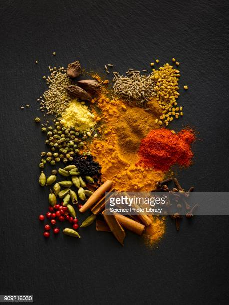dried spices on black slate - spice stock pictures, royalty-free photos & images