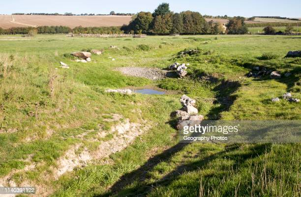 Dried up river bed and course in summer River Kennet West Overton Wiltshire England UK