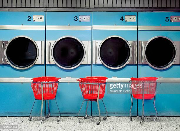 driers at laundromat - laundry stock pictures, royalty-free photos & images
