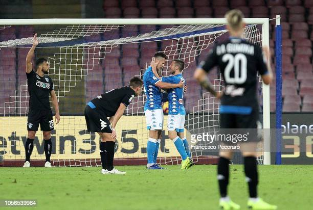 Dries Mertens and Arkadiusz Milik of SSC Napoli celebrate after scoring the 41 goal beside the disappointment of players of Empoli during the Serie A...