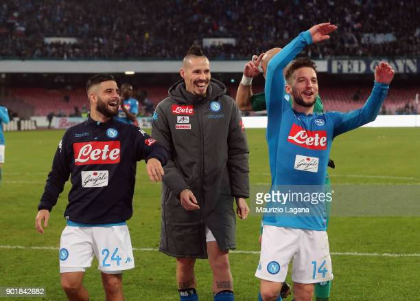Dries Mertens Marek Hamsik and Lorenzo Insigne of Napoli celebrate after the serie A match between SSC Napoli and Hellas Verona FC at Stadio San...