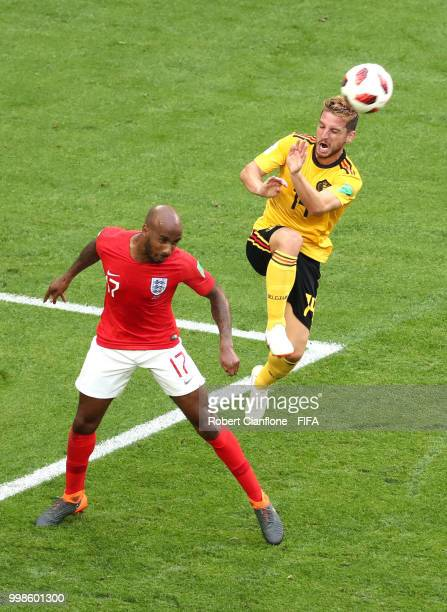 Dries Mertens of Belgium and Fabian Delph of England compete for the ball during the 2018 FIFA World Cup Russia 3rd Place Playoff match between...