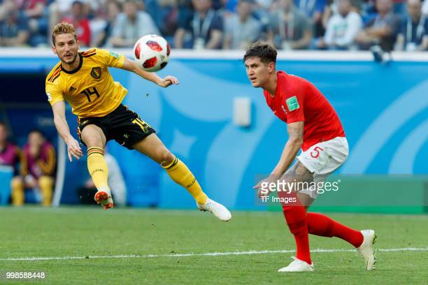 Dries Mertens of Belgium and John Stones of England battle for the ball during the 2018 FIFA World Cup Russia 3rd Place Playoff match between Belgium...