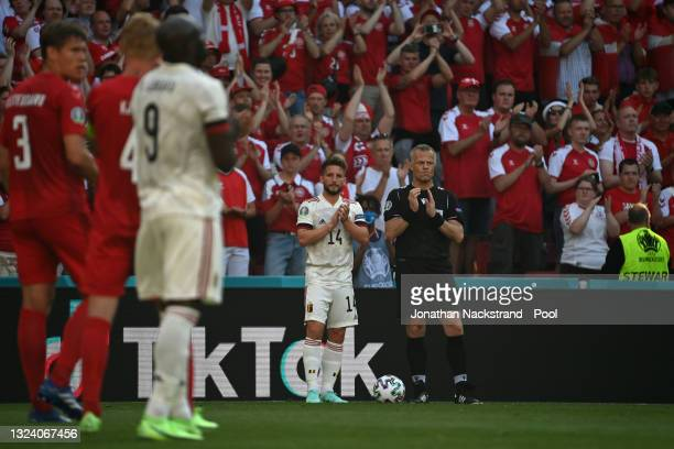 Dries Mertens of Belgium and Match Referee, Bjorn Kuipers applaud as the ball is kicked out of play in the tenth minute followed by a minute of...