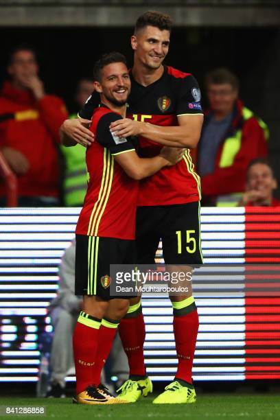 Dries Mertens of Belgium celebrates scoring his teams first goal of the game with team mate Thomas Meunier during the FIFA 2018 World Cup Qualifier...