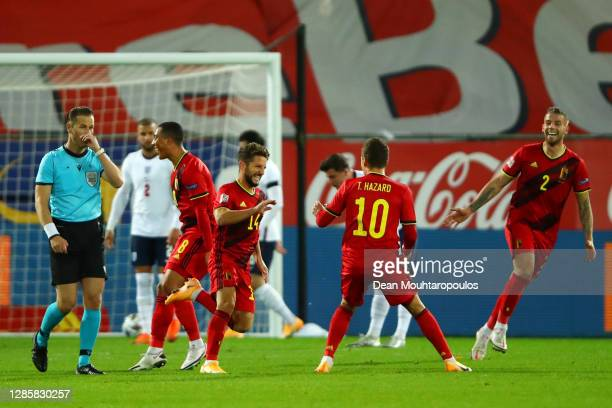 Dries Mertens of Belgium celebrates with teammate Thorgan Hazard after scoring his team's second goal during the UEFA Nations League group stage...