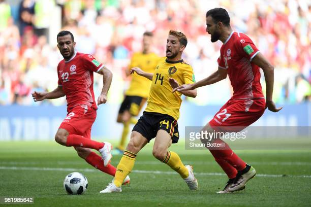 Dries Mertens of Belgium challenge for the ball with Hamdi Naguez and Ali Maaloul during the 2018 FIFA World Cup Russia group G match between Belgium...