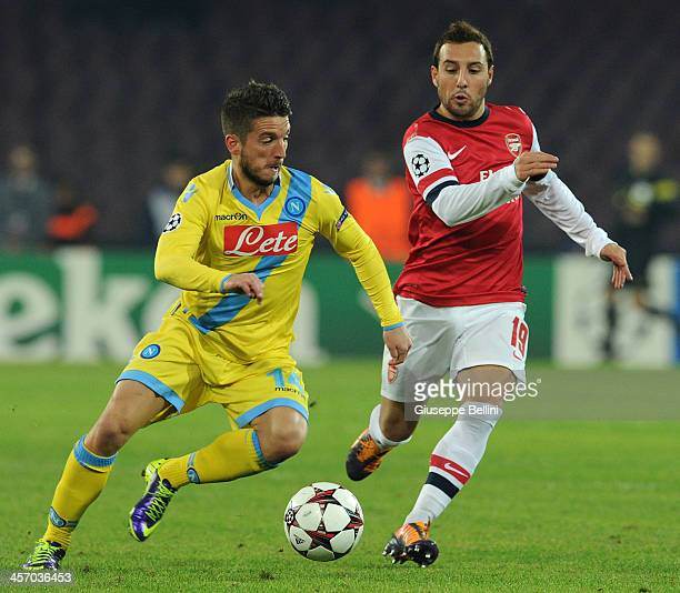 Dries Mertens of Napoli and Santi Cazorla of Arsenal in action during the UEFA Champions League Group F match between SSC Napoli and Arsenal at...