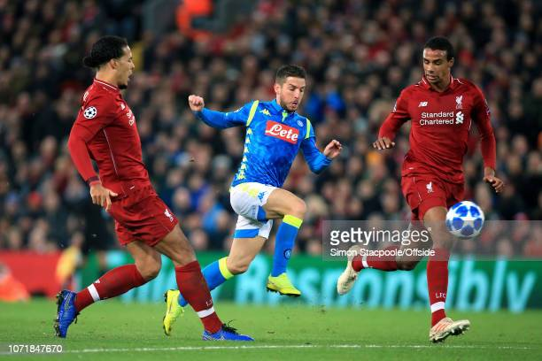 Dries Mertens of Napoli battles with Virgil van Dijk of Liverpool and Joel Matip of Liverpool during the UEFA Champions League Group C match between...